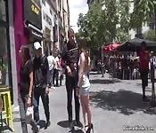 Naked brunette walking flag in public