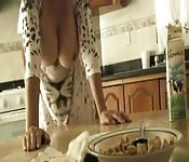 Sexy Latins milf exposes her boobs after dinner