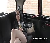Brunette with glasses gags in fake taxi