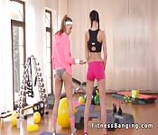 Lesbian teen licking her fitness trainer