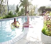 Two chicks having lesbian fun in pool