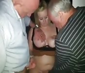 Old men grope a woman