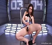 Slim brunette takes machine up her ass