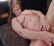 Mature woman experiments with sex toys