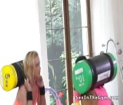Fit lesbians working squats in the gym