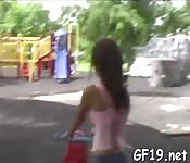 Young teen spreads her legs