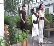 Slaves in white dresses fucked in public