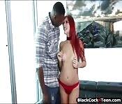 Slender redhead teen enjoying black cock