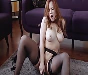 Sexy redhead babe plays with her pink pussy