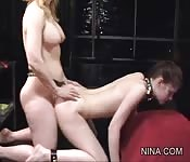 Justine submits to Nina.