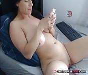 Huge tits babe fingering clit on cam