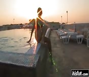 Naughty teen masturbates by the pool