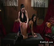 Busty babe spanks and anal fucks lesbian