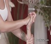 Busty brunette masseuse fingering blonde