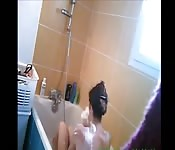 My naked sister washing her hair
