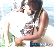 Ebony hottie taking white cock on beach
