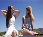 Two cute teen babes threesome in public