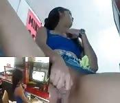 Sweet latina fucks herself behind the counter