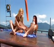 Lesbians pleasure each other on boat