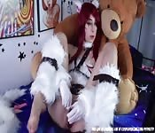 Crazy redhead girl plays roughly with her doll